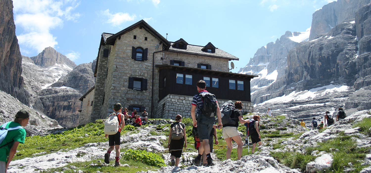 Hike in the mountains of Val di Sole: A completely stone-built refuge as destination.