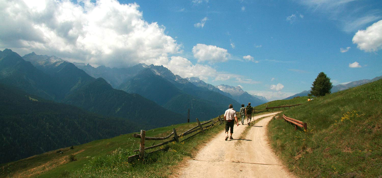 Trekking on a trail in the mountains of Trentino.