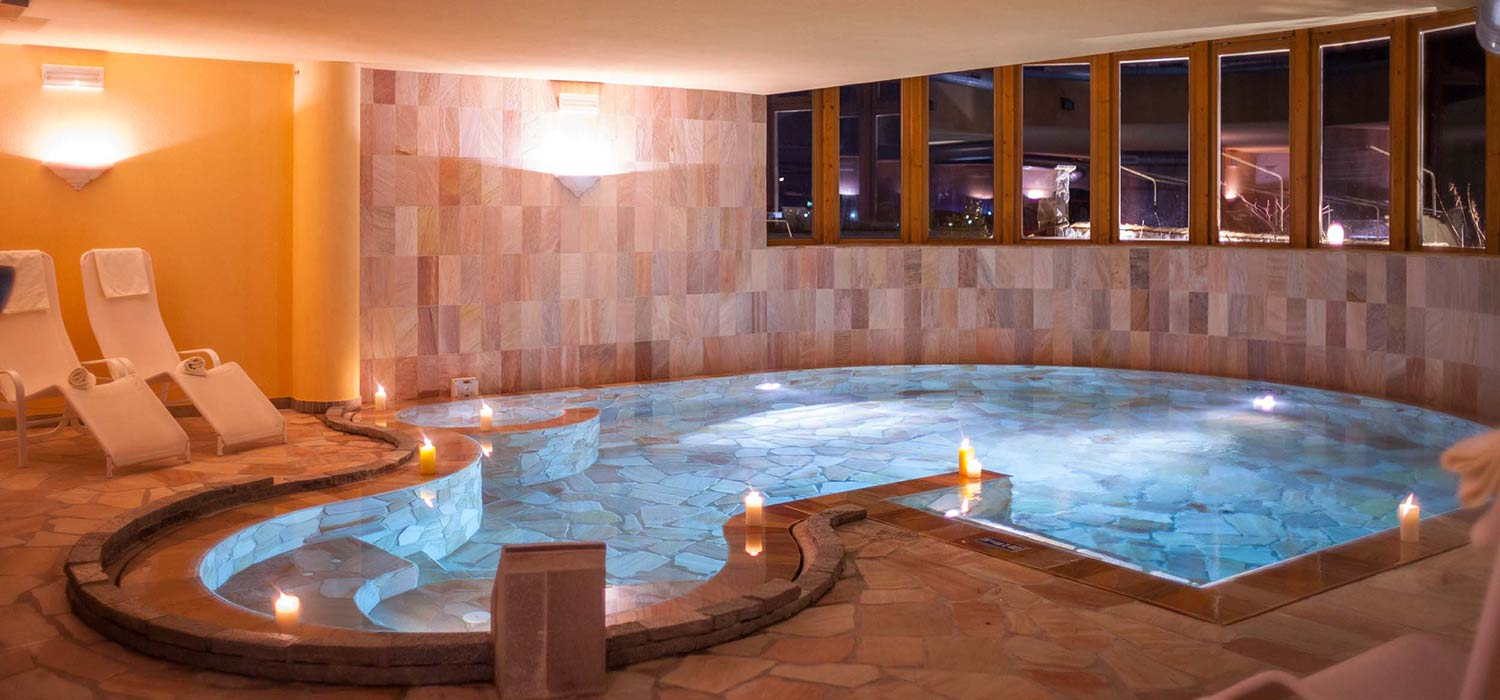 The indoor pool at Hotel Ariston. Elegantly clad in stone and with a great view outside.