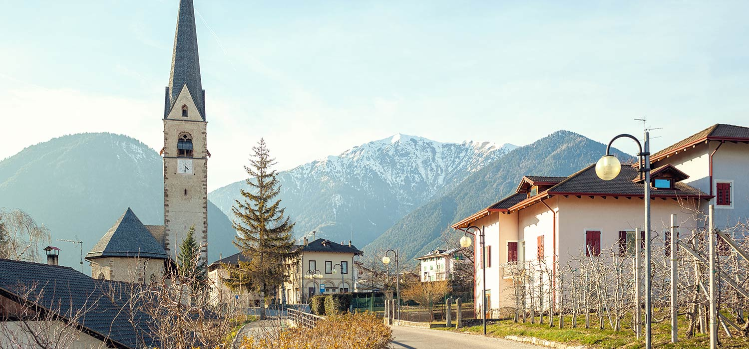 The village Monclassico Val di Sole - Trentino with the central church .